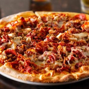 Tomato sauce, pepperoni, sausage, ham, bacon, mozzarella cheese