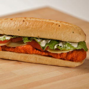 Buffalo chicken fingers, Buffalo sauce, lettuce, tomatoes, served with blue cheese